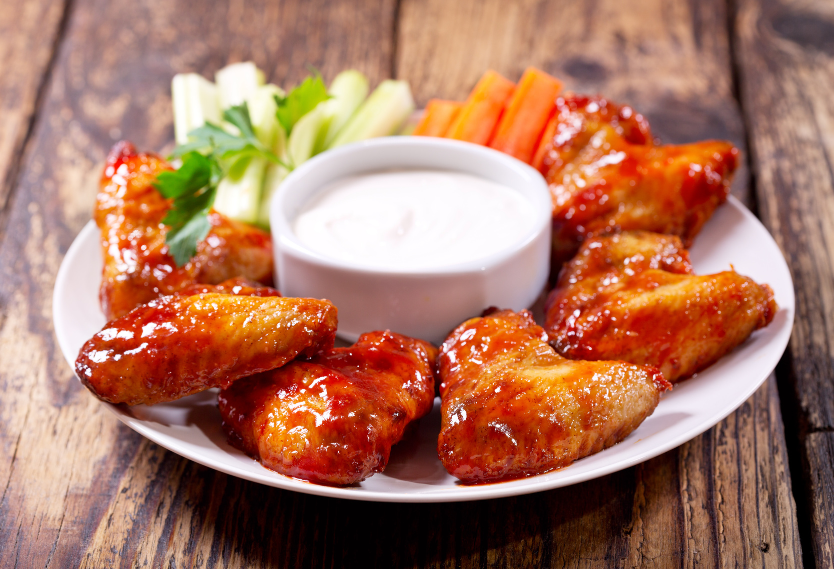 plate of fried chicken wings with sauce