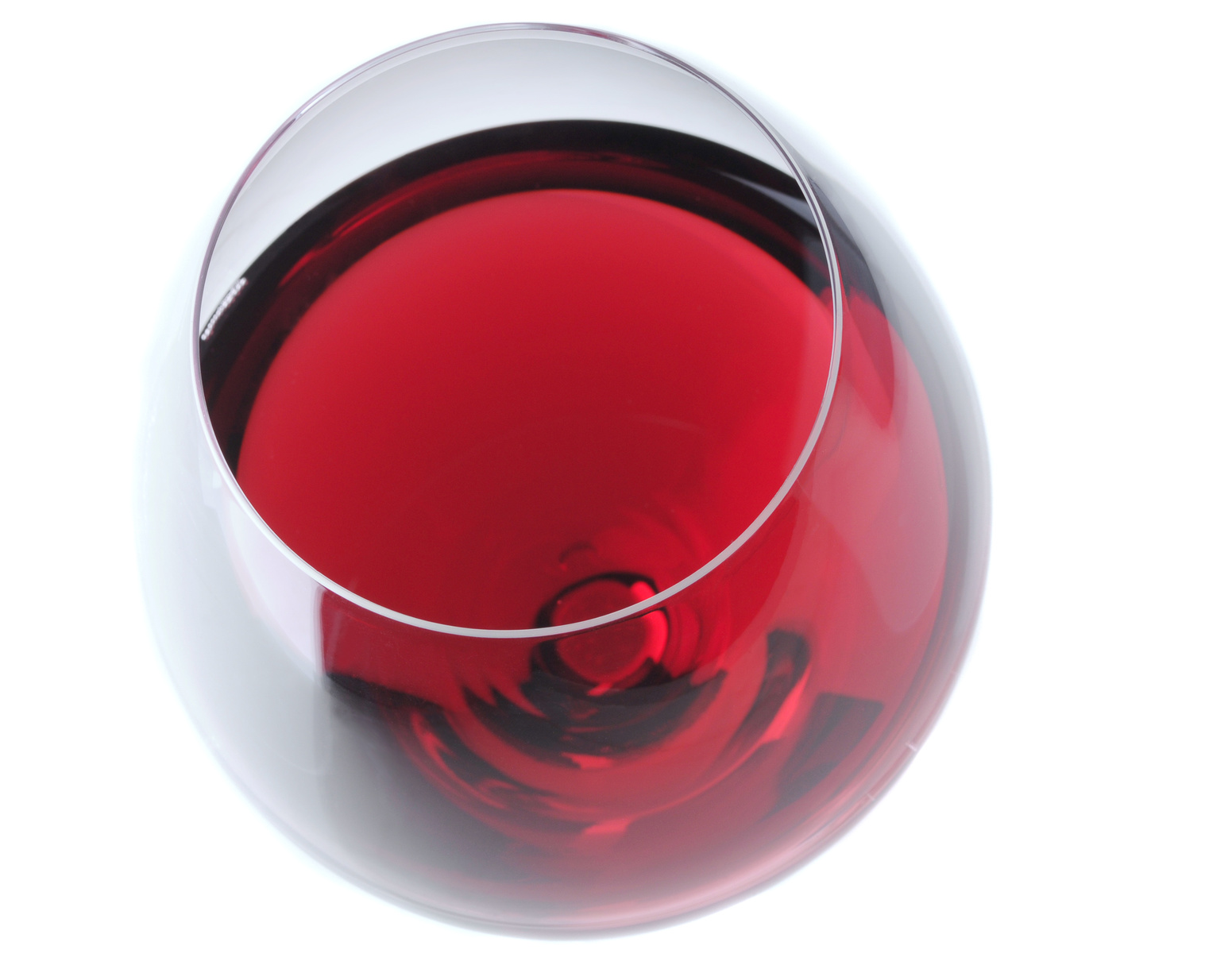 Red Wine Glass Viewed from high angle over light gray background with slight reflection